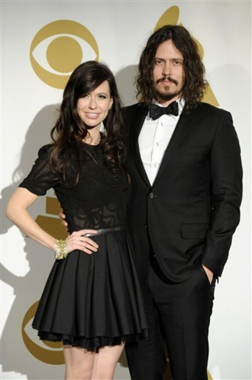 FILE - In this Nov. 30, 2011 file photo, Joy Williams, left, and John Paul White of the band The Civil Wars pose backstage at the Grammy Nominations Concert in Los Angeles. The duo has been nominated for best folk album and best country duo/group performance, two categories that bear little resemblance to each other. (AP Photo/Chris Pizzello, file)
