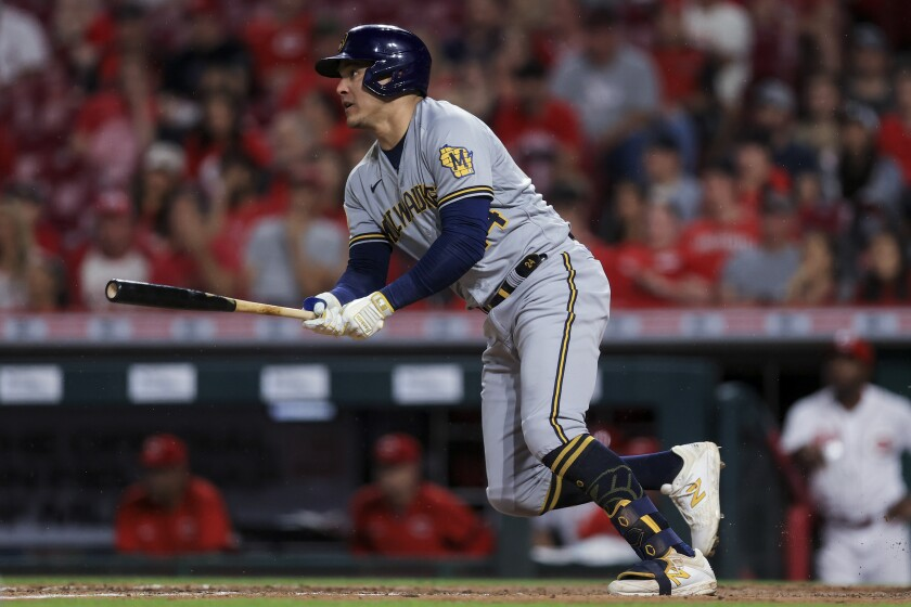 Milwaukee Brewers' Avisail Garcia watches his RBI single during the seventh inning of the team's baseball game against the Cincinnati Reds in Cincinnati, Tuesday, June 8, 2021. (AP Photo/Aaron Doster)