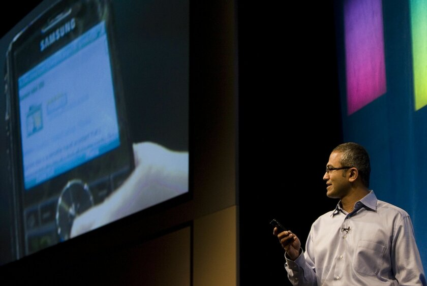 This May 21, 2008 photo, Microsoft Senior Vice President of Portal and Advertising Platform Group Satya Nadella demonstrates some of the features of Live Search on a mobile device during the advance08 Advertising Leadership Forum at the company's campus in Redmond, Wash.  Microsoft announced Tuesda
