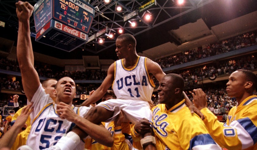 UCLA teammates give guard Tyus Edney a ride after he made the game-winning shot to beat Missouri 75-74 in the NCAA West Regional on March 19, 1995.