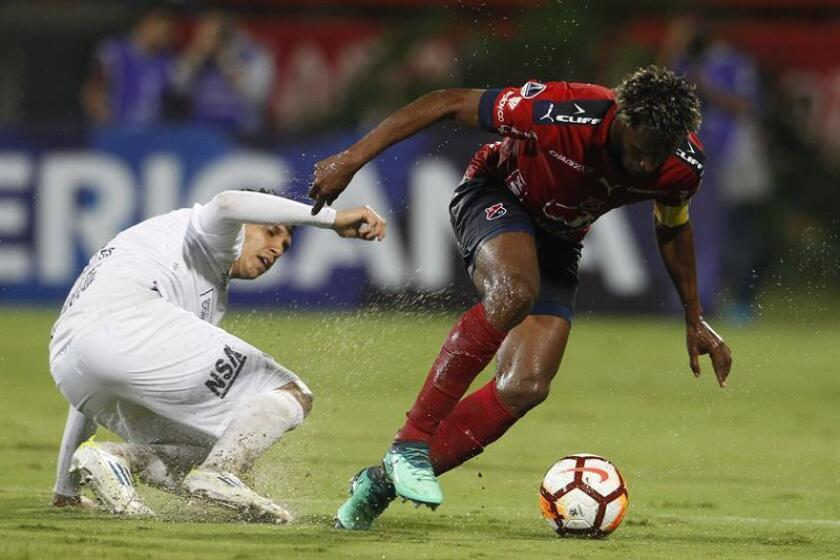 Didier Moreno from Independiente Medellin fights for the ball with Pablo Zeballos from Sol de America on May 10, 2018, at a Copa Sudamericana match at the Atanasio Girardot stadium in Medellin (Colombia). EPA- EFE FILE/LUIS EDUARDO NORIEGA