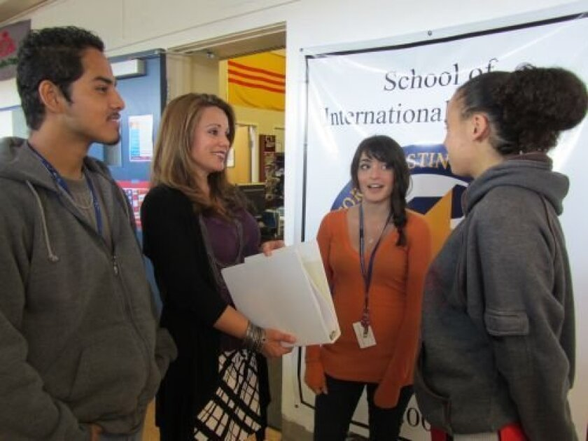 Principal Ana Diaz-Booz, second from left, with students at the School of International Business at Kearny High Educational Complex in Clairemont.