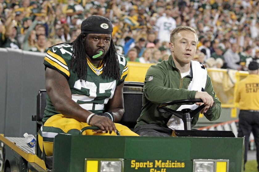 Green Bay Packers running back Eddie Lacy (27) is carted off the field after being injured during an NFL football game against the Seattle Seahawks, Sunday, Sept. 20, 2015 at Lambeau Field in Green Bay, Wis. (Wm. Glasheen/The Post-Crescent via AP) NO SALES