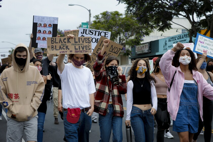 An estimated 400 protesters marched down Garnet Avenue in Pacific Beach.