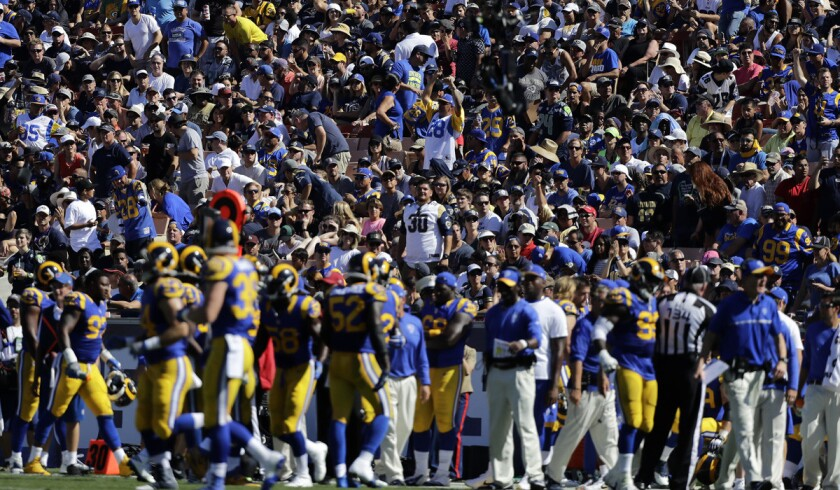 Fans watch the Los Angeles Rams play against Seattle at the Coliseum on Sunday.