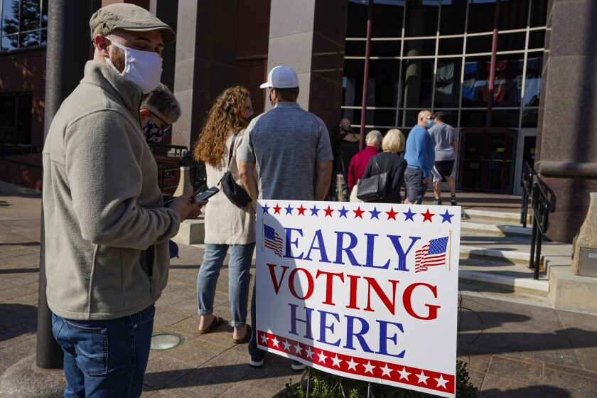 Voters wait in line at the Judicial Center in Noblesville, Indiana, on Oct. 7, four weeks before the election.