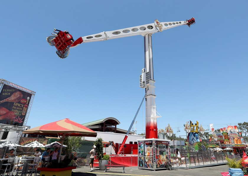 Riders flip as Titan takes them for a high-flying spin at the Orange County Fair in Costa Mesa. Titan is one of four new rides at this year's fair.