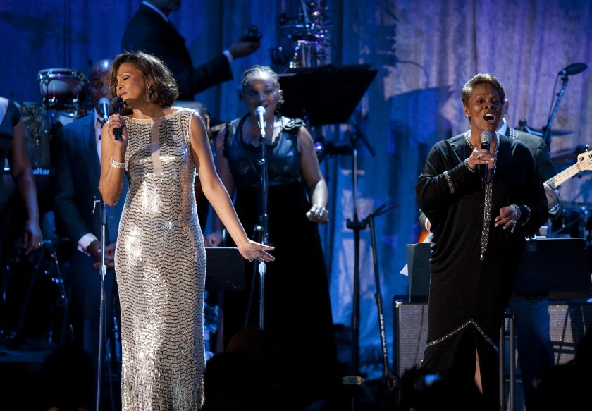 """Whitney Houston and Dionne Warwick sing """"That's What Friends Are For"""" at the 2011 Clive Davis pre-Grammy gala at the Beverly Hilton hotel."""