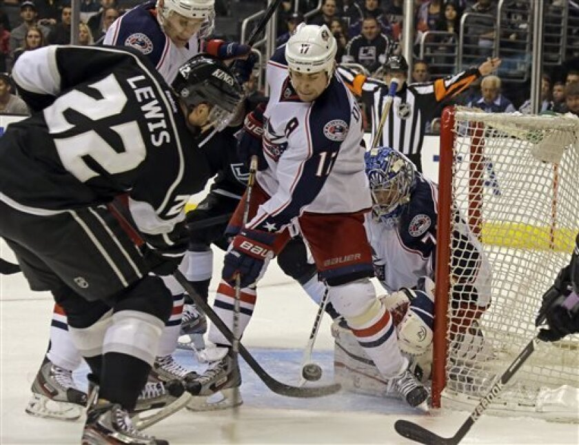 in the second period of an NHL hockey game in Los Angeles Thursday, April 18, 2013. (AP Photo/Reed Saxon)