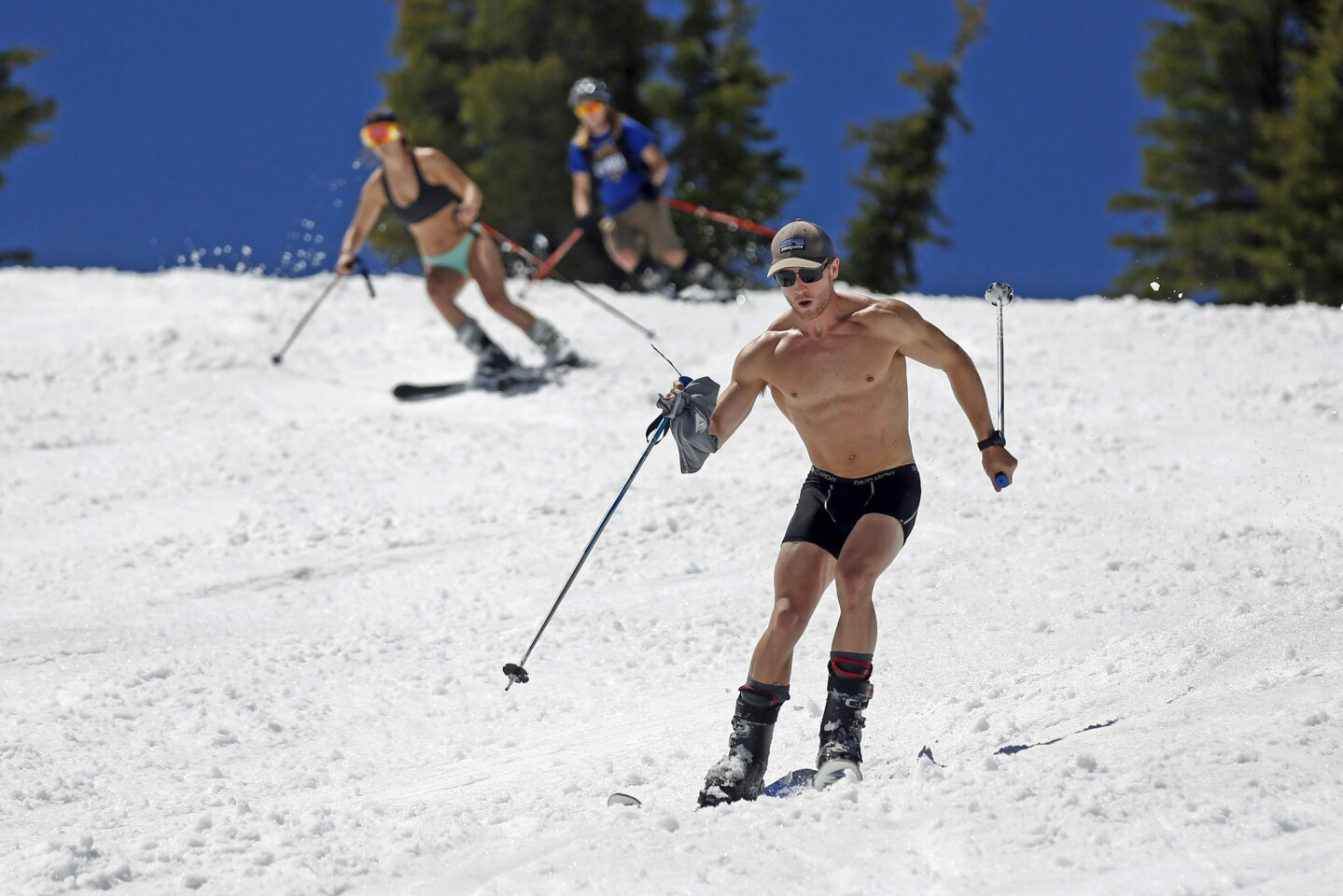 Bikini tops and snowcaps: Skiers at Squaw Valley Ski Resort in Olympic Valley, Calif.