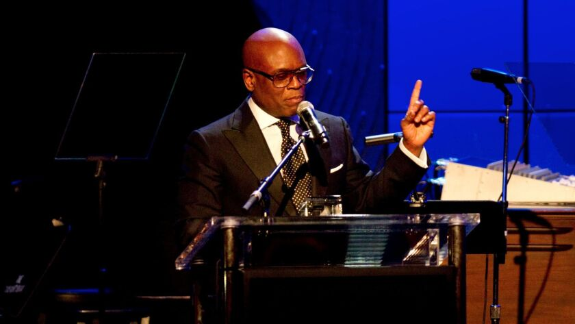 BEVERLY HILLS, CA - FEBRUARY 9, 2013: Honoree Antonio 'L.A.' Reid accepts an award at Clive Davis an