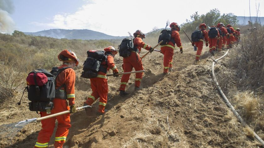 A crew of female firefighters from the California Dept. of Corrections Rainbow camp headed to perimeter of the Rangeland Fire on Thursday to start making a fire break to contain the blaze.
