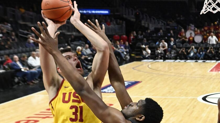 USC forward Nick Rakocevic, left, shoots as TCU center Kevin Samuel defends during the first half of the Air Force Reserve Classic on Friday at Staples Center.