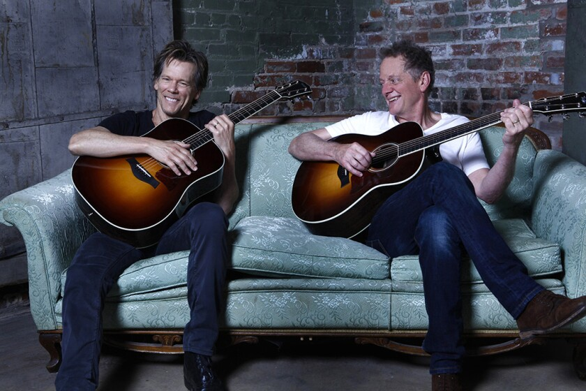 Kevin and Michael Bacon (right) have performed music together as the Bacon Brothers since 1995.