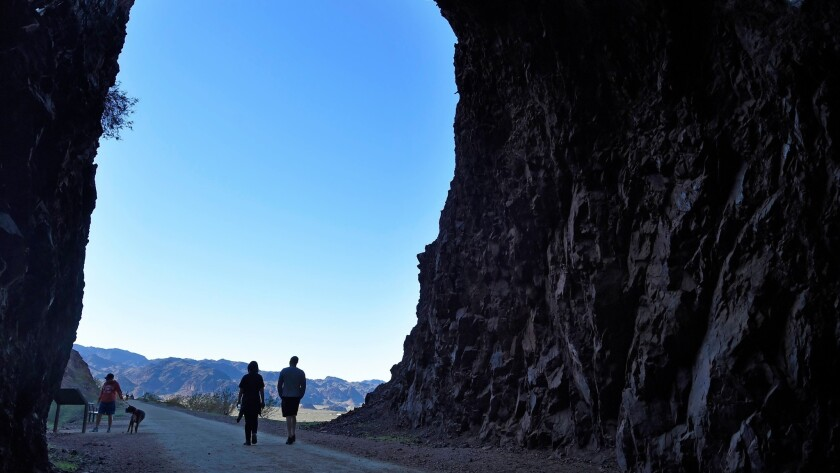 Hikers make their way along the Historic Railroad Trail Tuesday, February 28, 2017, in the Lake Mead