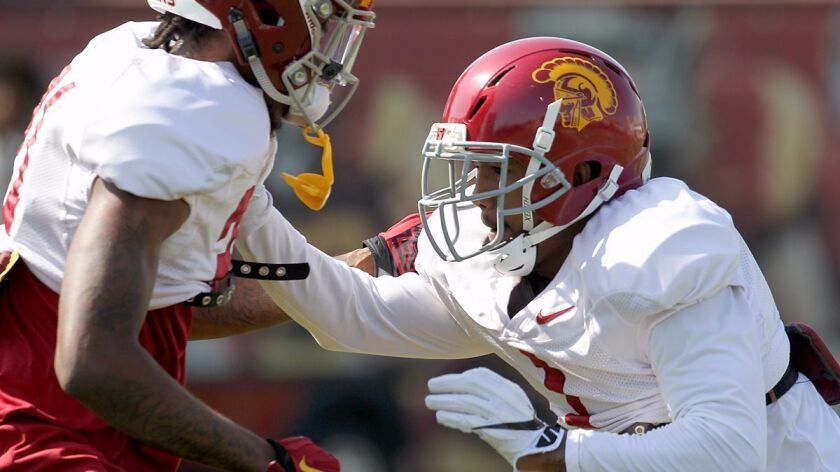 USC cornerback Jack Jone, right, participates in spring practice at USC on Tuesday.