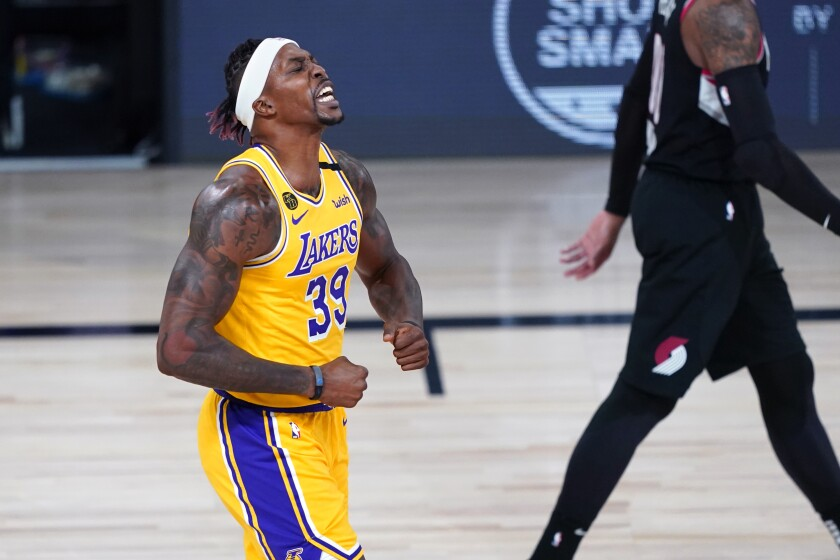 Lakers center Dwight Howard reacts after a slam dunk.