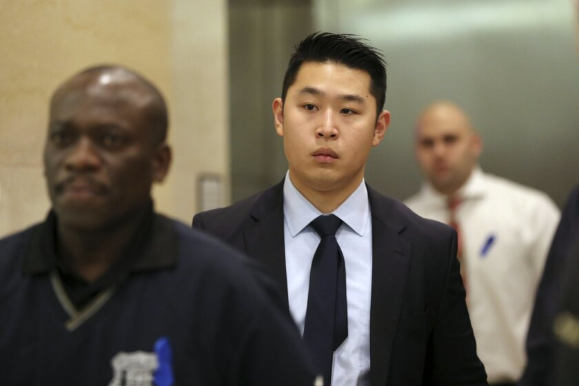 FILE - In a Tuesday, Feb. 9, 2016 file photo, Police officer Peter Liang, center, exits the courtroom during a break in closing arguments in his trial on charges in the shooting death of Akai Gurley, , at Brooklyn Supreme court in New York. Brooklyn District Attorney Kenneth Thompson said Wednesday, March 23, 2016, that he has recommended that Liang serve no time behind bars. Liang was convicted of a manslaughter charge in February after the 2014 shooting death of Akai Gurley. The rookie officer was dismissed following the verdict. (AP Photo/Mary Altaffer, File)