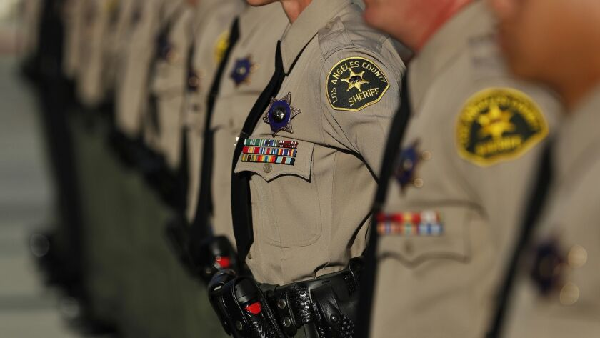 Los Angeles County sheriff's deputies stand at attention.