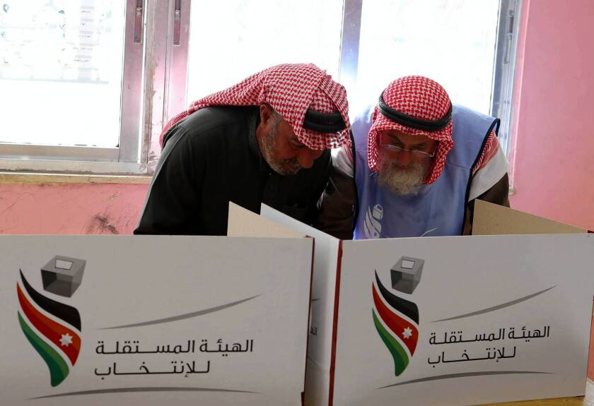 Jordanians vote in parliamentary elections at a station in the Baqaa Palestinian refugee camp near Amman.