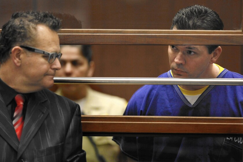 John Lenzie Creech, right, is accused of killing 20th Century Fox executive Gavin Smith in May 2012. Above, he appears with his attorney, Alex Kessel, for his arraignment in Los Angeles County Superior Court in February.