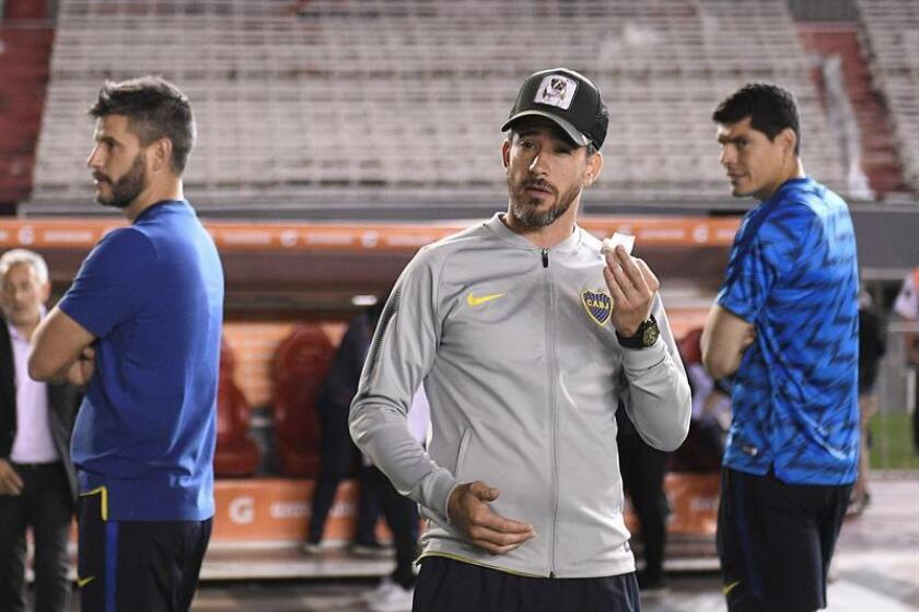 El jugador de Boca Juniors, Pablo Pérez luego de la suspensión del partido de la final de la Copa Libertadores entre River Plate y Boca Juniors. EFE/Archivo