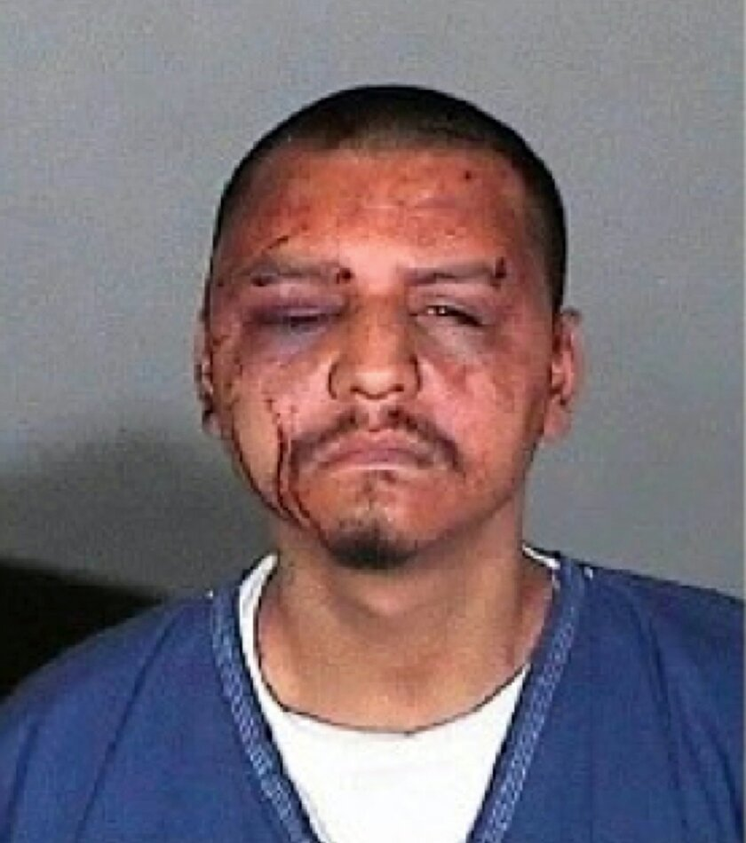 FILE - This undated evidence file photo provided by the U.S. Attorney's Office and taken by the Los Angeles County Sheriff's Department shows Gabriel Carrillo in Los Angeles. The former Los Angeles County sheriff's deputy convicted in the beating of Carrillo, a jail visitor who was handcuffed and a