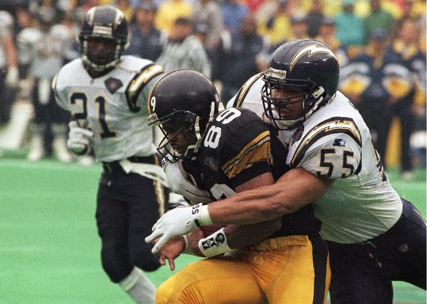This Junior Seau tackle of Pittsburgh Steeler Ernie Mills in the 1994 AFC Championship game was among the big plays for which Seau was celebrated at the Pro Football Hall of Fame's Gold Jacket Ceremony on Thursday. (AP Photo/Keith Srakocic, File)