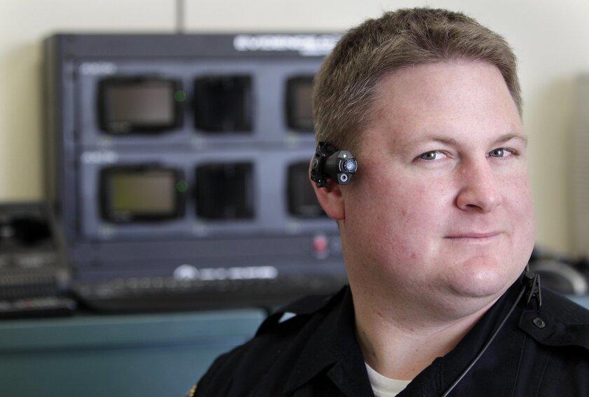 Coronado police Sgt. Matt Mitchell shows how the Taser Axon video operates
