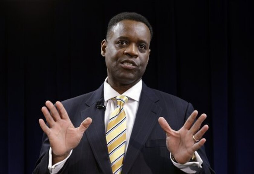 Kevyn Orr anwsers a question during a news conference in Detroit, Thursday, March 14, 2013. Gov. Rick Snyder announced that he had chosen Orr, a partner in the Cleveland-based law and restructuring Jones Day firm, as Detroit's emergency manager.  Snyder's already declared a financial emergency in D