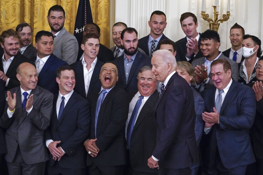 Los Angeles Dodgers manager Dave Roberts, third from bottom left, reacts as President Joe Biden arrives to an event to honor the 2020 World Series champion Dodgers baseball team at the White House, Friday, July 2, 2021, in Washington. (AP Photo/Julio Cortez)