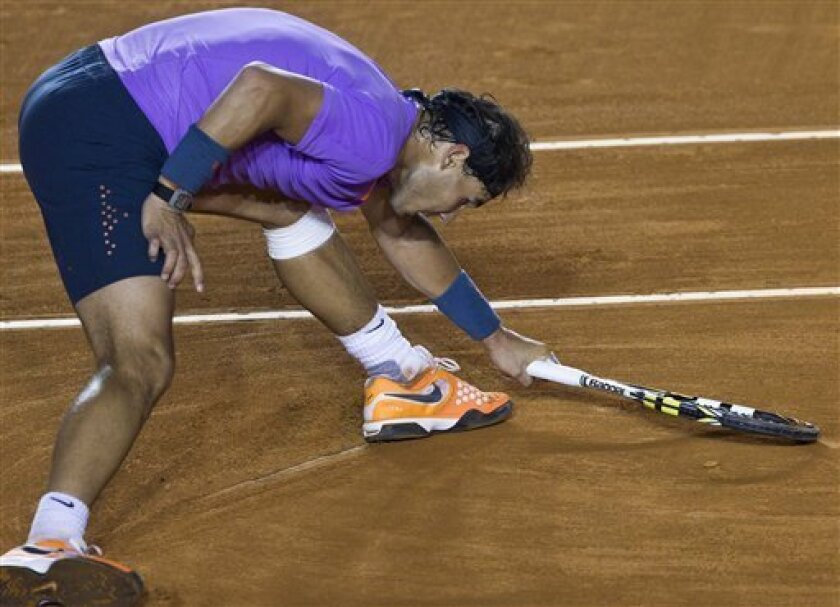 Spain´s  Rafael Nadal during a match against Argentina´s Leonardo Mayerat the Mexican Open in Acapulco, Mexico, Thursday, Feb.  28, 2013. Nadal won  6-1, 7-5 to reach the Mexican Open semifinals.(AP Photo/Christian Palma)