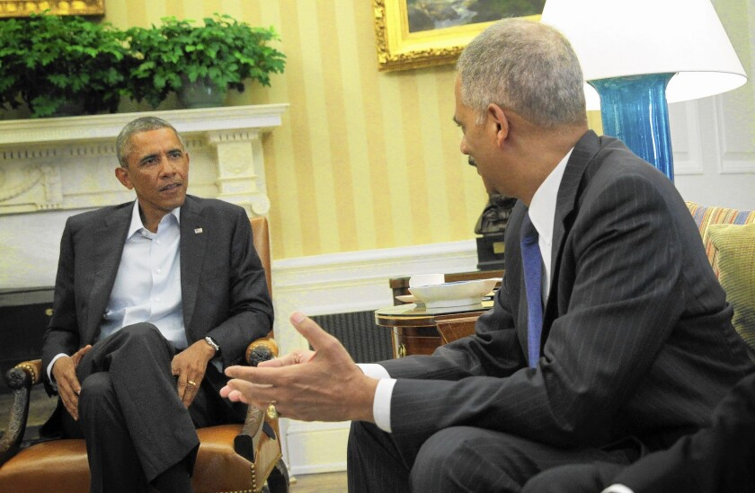 President Obama meets with Atty. Gen. Eric H. Holder Jr. in the Oval Office on Monday.