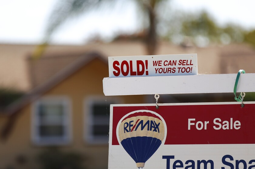 A sold sign is displayed outside of a Clairemont home.