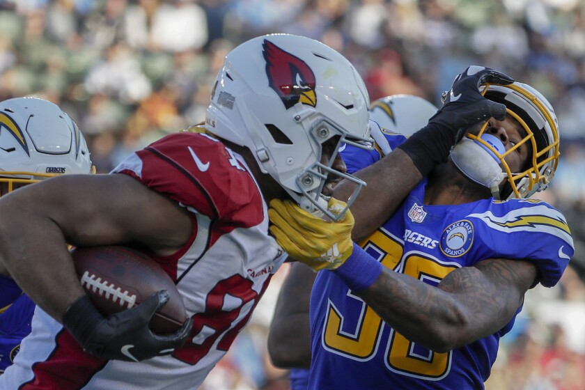Chargers safety Derwin James wrestles with Arizona Cardinals tight end Jermaine Gresham during third-quarter action at StubHub Center on Sunday.