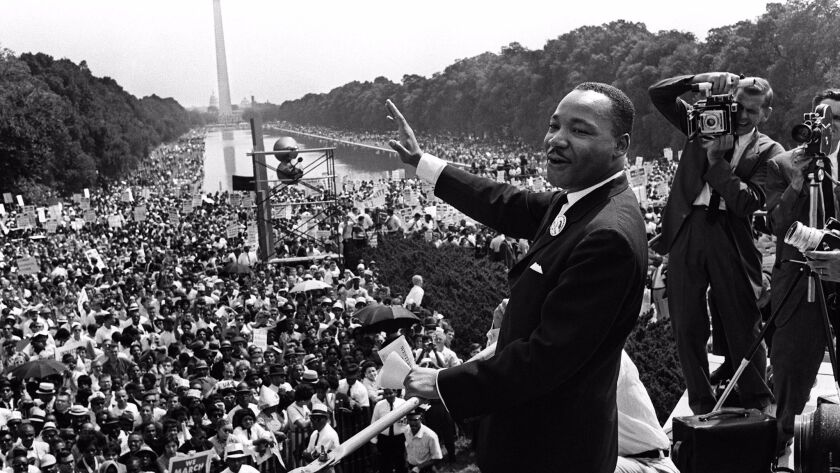 """This Aug. 28, 1963, file photo shows civil-rights leader Martin Luther King Jr. waving from the steps of the Lincoln Memorial to supporters on the Mall in Washington, D.C., during the """"March on Washington."""""""
