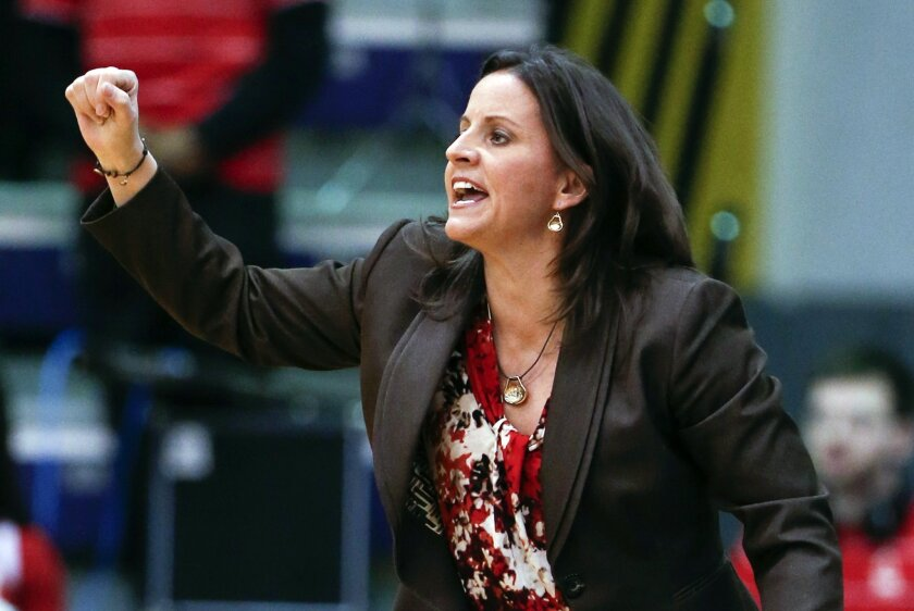 FILE - In this March 13, 2015, file photo, Hartford head coach Jennifer Rizzotti signals to her players during the first half an NCAA college basketball game in the America East Conference tournament championship against Albany in Albany, N.Y. George Washington has hired Rizzotti as its new women's