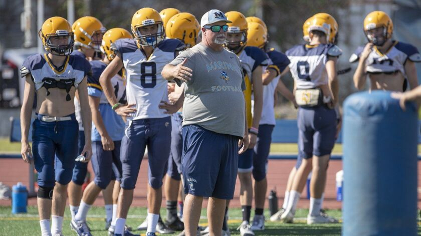 Marina's head coach Jeff Turley gives instructions to his team during practice on Wednesday, August