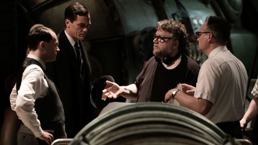 """Michael Stuhlbarg, from left, Michael Shannon, Guillermo del Toro and David Hewlett on the set of """"The Shape of Water."""""""