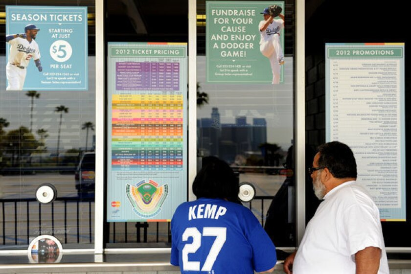 Dodger fans purchase tickets outside Dodger Stadium.