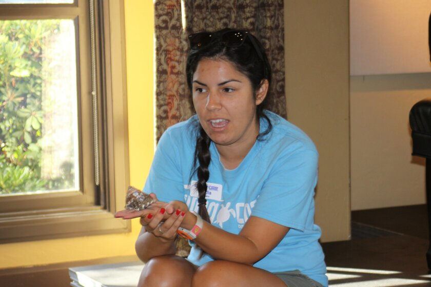 Living Coast Discovery Center instructor Cadia Hernandez shows a shell before she brings out the snail that lives in that type of shell.