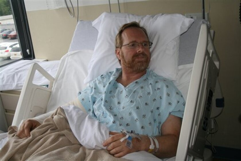 Robert Miller, 54, recovers from a bear attack in his hospital room in Anchorage, Alaska, on Wednesday, June 23, 2010.  The bear attack occurred June 20 as Miller, a Millrock Resources Inc. geologist working near Rainy Pass in the Alaska Range, waited for a helicopter to pick him up. Miller was usi