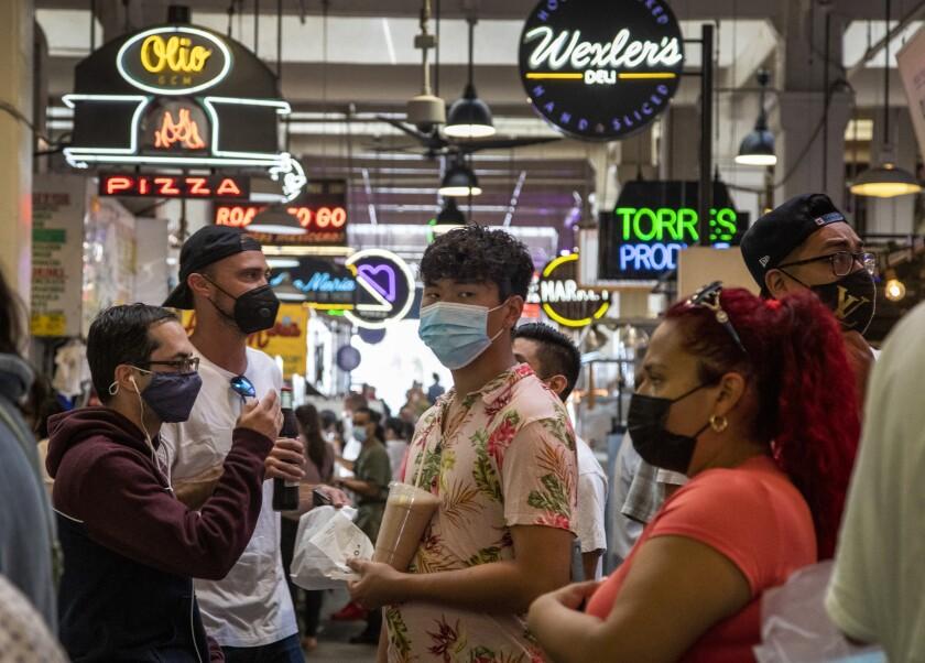 People in masks visit Grand Central Market