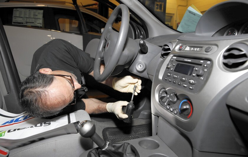 GM has repaired a little more than 60% of almost 2 million older cars equipped with a defective ignition switch linked to at least 42 deaths. Above, a technician in New Hudson, Mich., makes repairs to the ignition switch on a Saturn Ion.