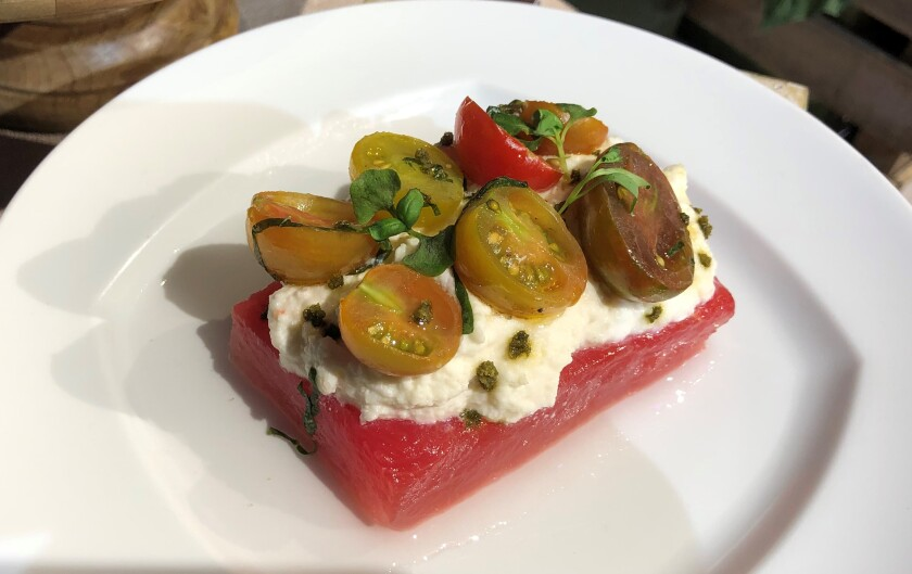 Compressed Watermelon and Tomato with Whipped Ricotta and Lemon Olive Oil at the Disney California Adventure 2020 Food & Wine Festival.