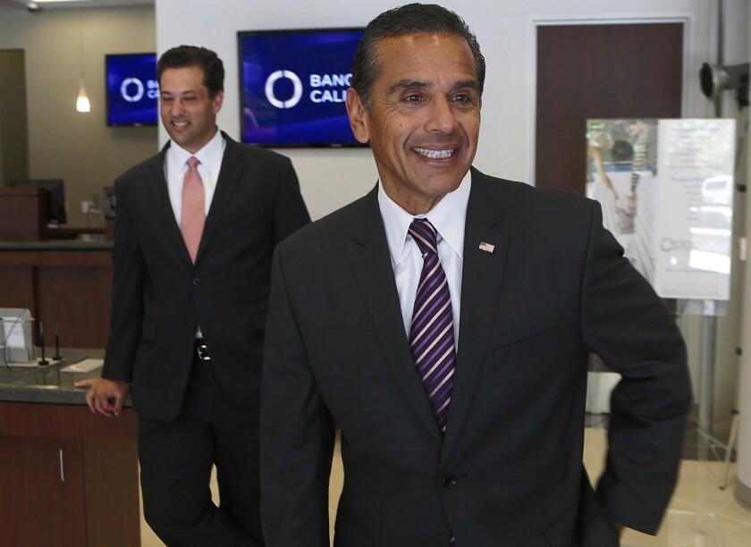 Former Los Angeles Mayor Antonio Villaraigosa, right, visits a Century City bank branch in July 2013 with Steven A. Sugarman, president and chief executive officer of Banc of California, Inc. Villaraigosa is an advisor to the bank.