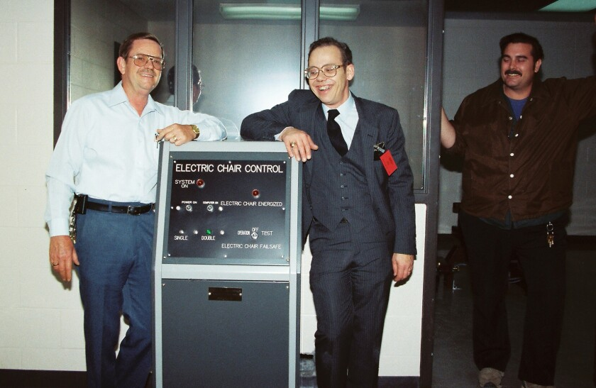 In this undated photo released by Fred Leuchter (right), he stands near the control panel for the electric chair he built. Leuchter says he is afraid the chair will malfunction at an execution scheduled for Thursday because of later modifications.