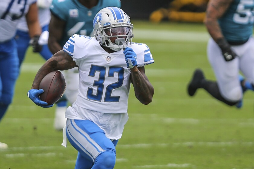 FILE- In this Sunday, Oct. 18, 2020, file photo, Detroit Lions running back D'Andre Swift (32) carries the ball during an NFL football game against the Jacksonville Jaguars in Jacksonville, Fla. The Detroit Lions are hosting the Indianapolis Colts hoping to win three straight games for the first time in three seasons under coach Matt Patricia. The Colts are aiming to improve to 3-0 coming off bye weeks with coach Frank Reich. (AP Photo/Gary McCullough, File)