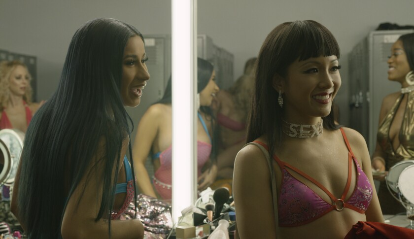 """Cardi B and Constance Wu in the movie """"Hustlers."""""""