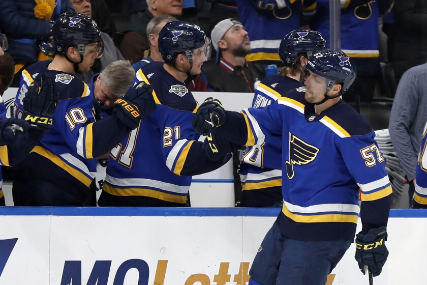 St. Louis Blues forward David Perron is congratulated by Tyler Bozak (21) and Brayden Schenn after scoring  against the Colorado Avalanche on Dec. 16.